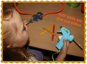 glue gun and popsicle sticks